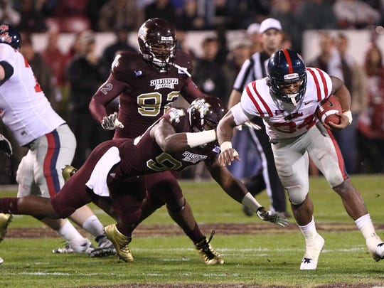 Ole Miss running back Brandon Bolden runs past MSU