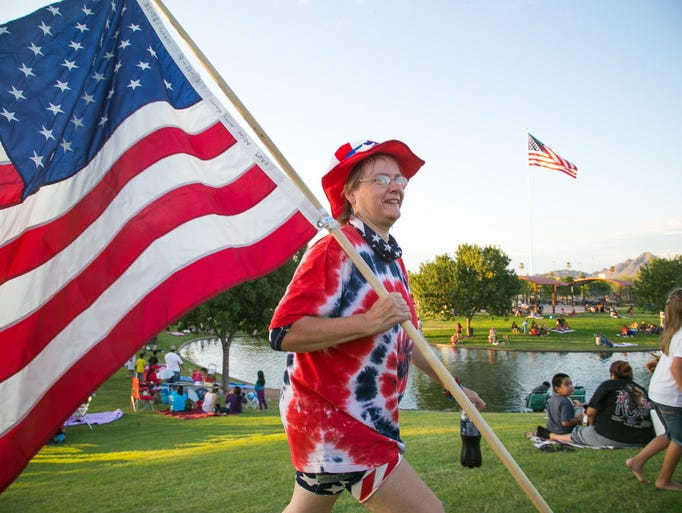 Cindy Achtzehn shows her patriotic colors at the Fabulous Phoenix 4th of July celebration at Indian Steele Park in Phoenix on Friday, July 4, 2014.