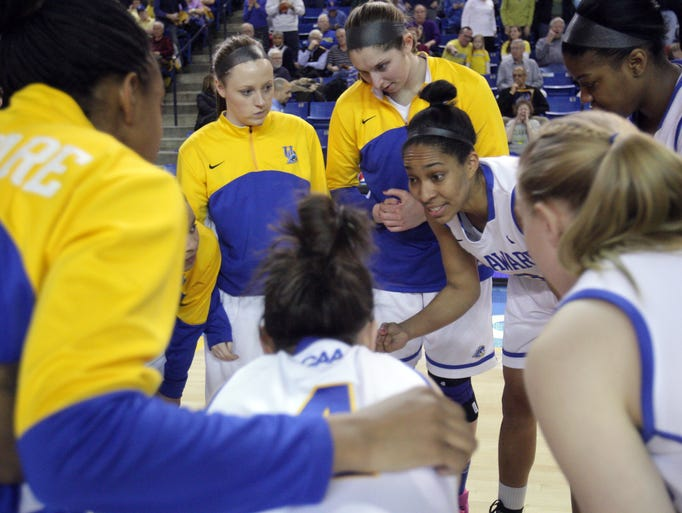 Delaware forward Kelsey Buchanan leads her team in the pregame huddle before taking on James Madison at the Bob Carpenter Center, Thursday, Feb. 20, 2014.