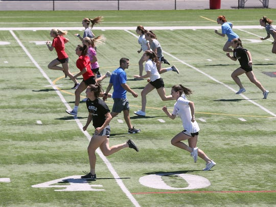Penfield High School students work out at the school's