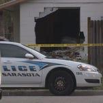 Car crashes into Sarasota home.