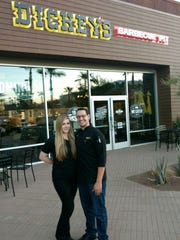 Franchisees Steven and Haley Frydrych smile in front of the new Dickey's Barbecue Pit location in Rancho Mirage.