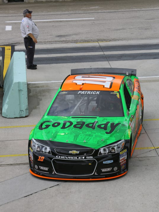 Danica Patrick (10) drives into the garage area after practice for Sunday's NASCAR Sprint Cup Series auto race, Saturday, Nov. 21, 2015, at Homestead-Miami Speedway in Homestead, Fla. (AP Photo/David  Graham)