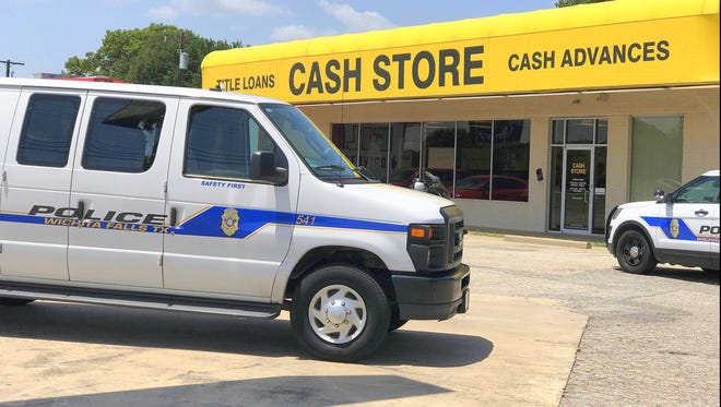The Wichita Falls Police Department investigate an armed robbery that happened at about 1:30 p.m. Tuesday at Cash Store located at 1506 Southwest Parkway.