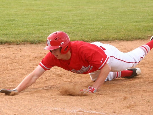 West Lafayette's Colin Merriott slides back to first