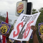 Protesters participate in a rally outside a Burger King on Chicago's South Side to raise the minimum wage for employees to $15 an hour.