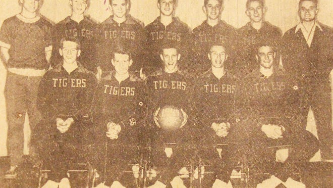 The 1948-49 La Junta High School state boys basketball champion. Back row, from left, coach Bob Hemphill, Tam Stubbs, Kenneth Wilks, Dick Pitcher, Don Woods, Keith Lance and manager Duane Pew. Front row, from left, Bob McCandless, Jerry Lear, Jerry Burton, John Driscoll and Ed Rhodes.