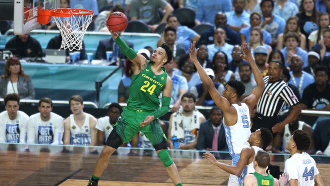 Oregon forward Dillon Brooks (24) goes up for a layup while being guarded by North Carolina forward Tony Bradley (5) during the first half of the NCAA Final Four semifinals at the University of Phoenix Stadium in Glendale, Ariz. on April 1, 2017.