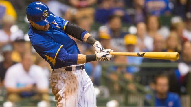 Ryan Braun hits a two-run single during the seventh inning.