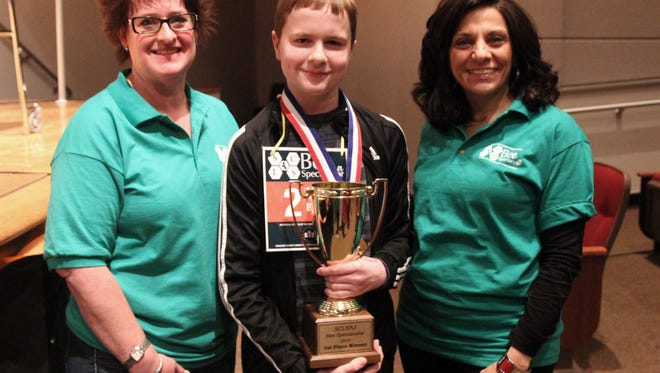 SCLSNJ Bee Spectacular co-chairs Catherine DeBerry and Marcela Dunham pose with SCLSNJ's first place spelling bee champion Henry Banta.