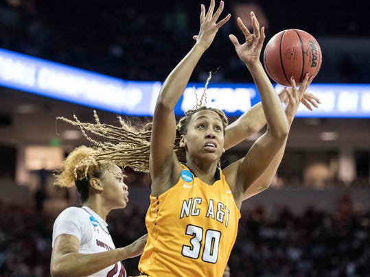 North Carolina A&T forward Quenswayla Story battles for a rebound against South Carolina during the first half of game in the first-round of the NCAA women's college basketball tournament, Friday, March 16, 2018, in Columbia, S.C. (AP Photo/Sean Rayford)
