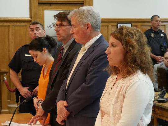 Nicole Addimando (at left, looking down) with her two defense attorneys, Benjamin Ostrer and John Ingrassia, in Dutchess County Court during her arraignment. To the right is Putnam County Assistant District Attorney Chana Krauss, who is prosecuting the case.
