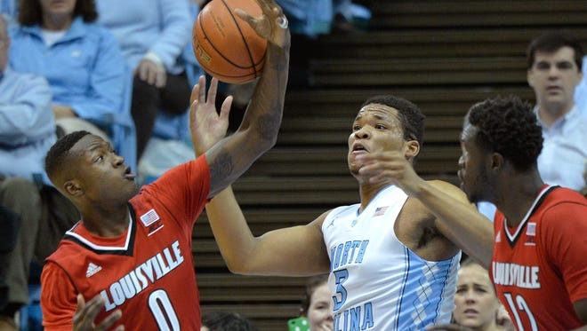 CHAPEL HILL, NC - JANUARY 10:  Terry Rozier #0 of the Louisville Cardinals battles for a rebound with Kennedy Meeks #3 of the North Carolina Tar Heels during their game at the Dean Smith Center on January 10, 2015 in Chapel Hill, North Carolina.  (Photo by Grant Halverson/Getty Images)