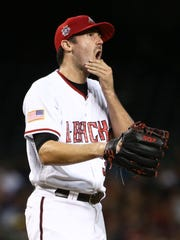 Arizona Diamondbacks pitcher Robbie Ray reacts after