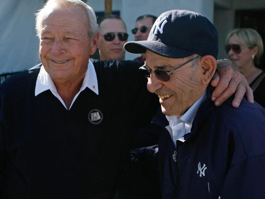 Arnold Palmer (left), seen here with baseball star Yogi Berra, has his name throughout the history books of the CareerBuilder Challenge.