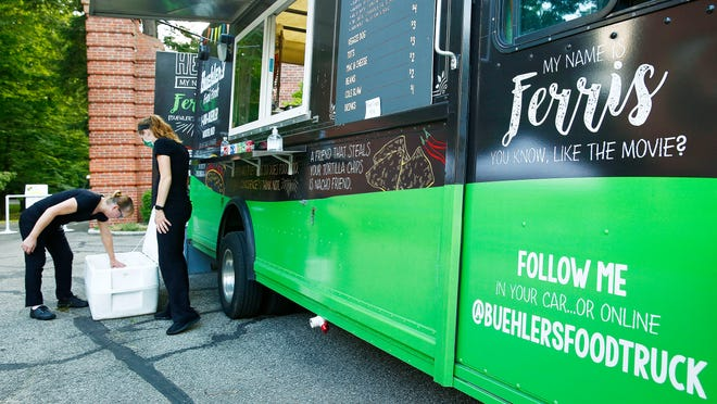 "Catering specialists Myrna Farriss, left, and Zoe Bates man the Buehler's Fresh Foods' traveling food truck, Ferris, during Kingwood Center Gardens' Live On the Lawn summer concert Thursday. A Florida-based company has filed an opposition with the Trademark Trial and Appeal Board over the name ""Ferris."""