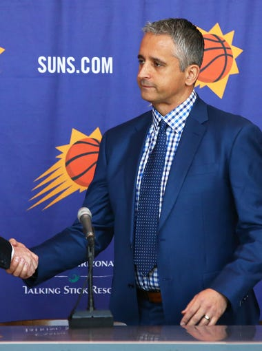 Phoenix Suns General Manager Ryan McDonough welcomes new head coach Igor Kokoskov (center) during a press conference on May 14, 2018 at Taking Stick Resort Arena in Phoenix, Ariz.