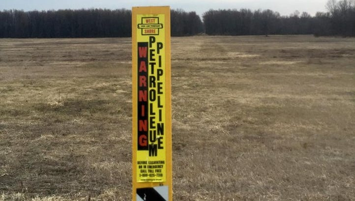 A sign identifies the West Shore Pipe Line Co. right-of-way south of Pleasant Valley Road in the Town of Jackson.