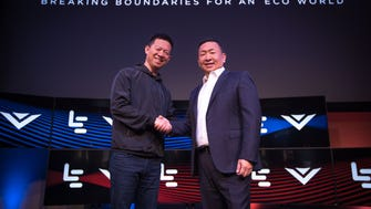 LeEco CEO YT Jia, VIZIO CEO William Wang at LeEco and VIZIO Press Conference in Hollywood where it was announced that LeEco had acquired VIZIO for $2 billion