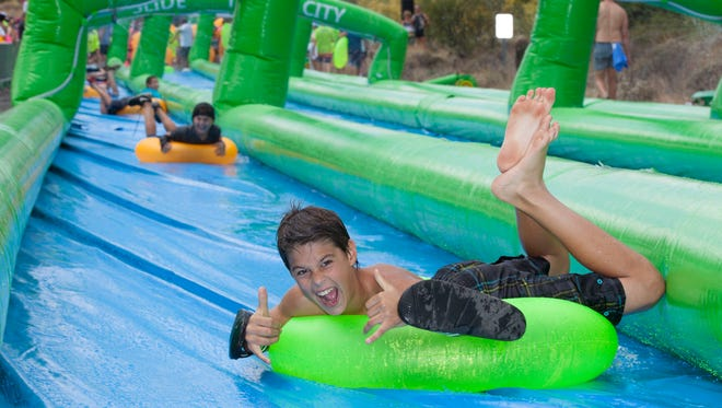 Photo of Slide the City's giant waterslide adventures in other cities.