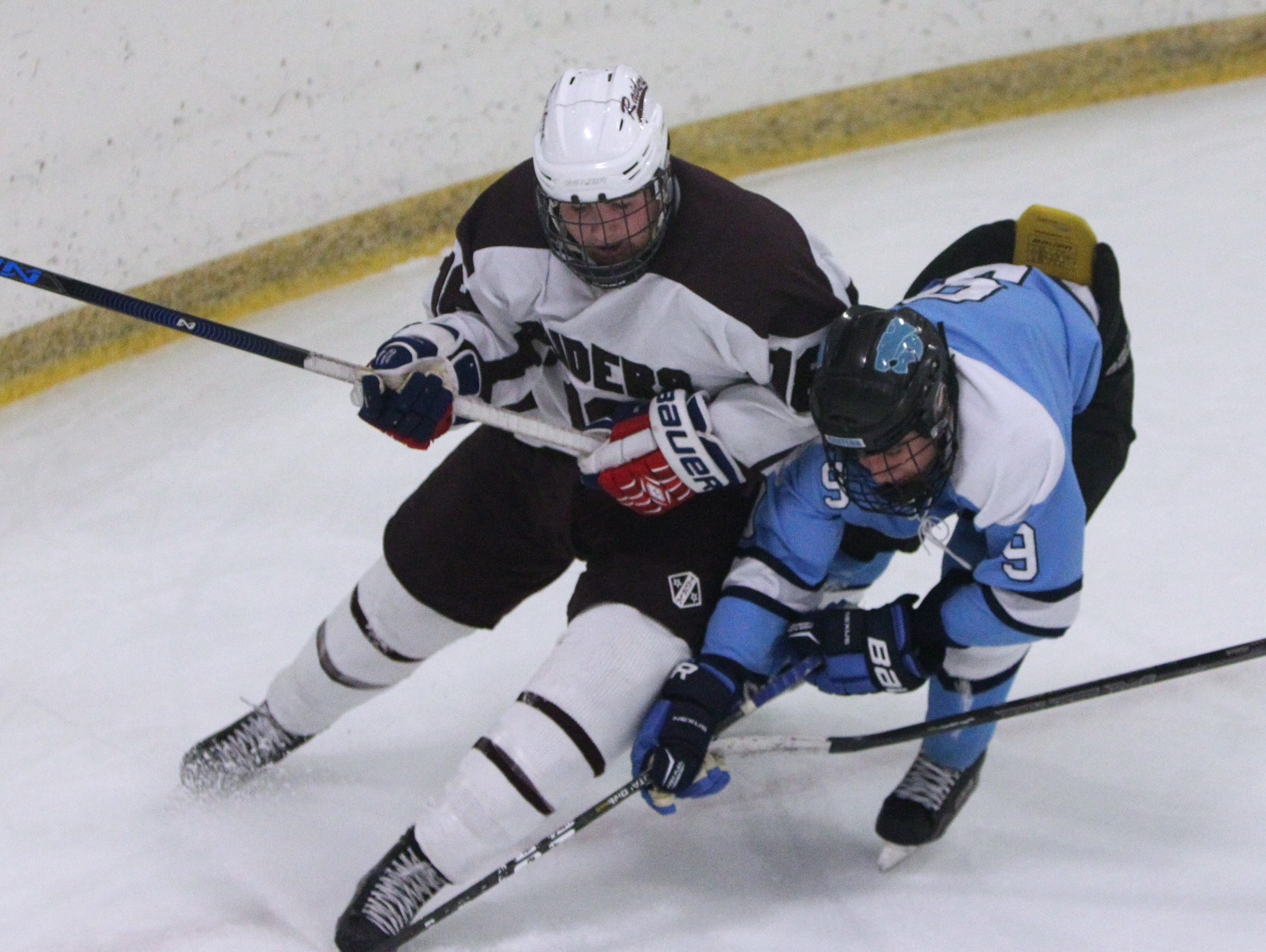 Scarsdale's Erin Nicholas, left, fights for the puck with Suffern's Tim Patwell during their game at the E.J. Murray rink in Yonkers Dec. 7, 2015. Scarsdale won 1-0.