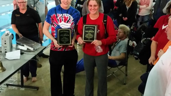 West Henderson's Jake Johnson and Tuscola's Cora Dodson were the Western North Carolina Athletic Conference swim meet's most valuable performers.