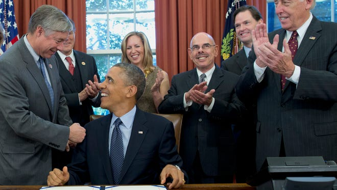 President Barack Obama shakes hands with Rep. Fred Upton, R-Mich., in the Oval Office on Nov. 13 after signing the School Access to Emergency Epinephrine Act.