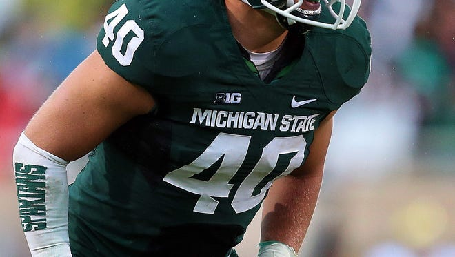 Michigan State Spartans linebacker Max Bullough (40) before the snap of the ball during the 2nd half of a game against the Michigan Wolverines at Spartan Stadium. MSU won 29-6.