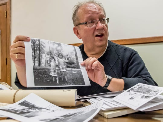 Local historian Kurt Thornton shows some of his Battle Creek memorabilia.