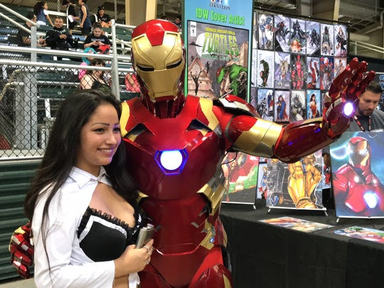 """A costume player poses with """"Iron Man"""" at the second"""