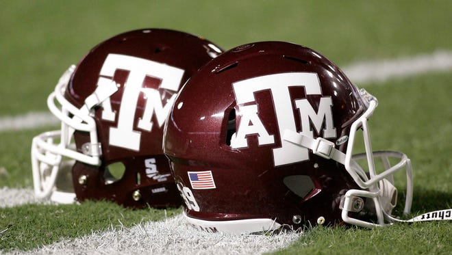 Two Texas A&M football assistant coaches brought the worst kind of attention to their program Friday.