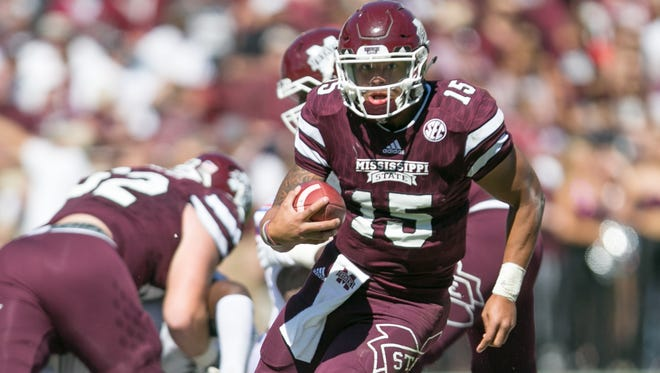 Mississippi State quarterback Dak Prescott (15) carries for a first down in the first half against Louisiana Tech Saturday at Davis Wade Stadium in Starkville.