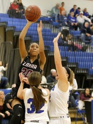 Zaria DeMember-Shazer of Elmira puts up a shot over