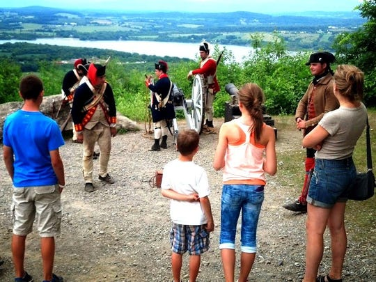 Re-enactors interact with visitors to tell the story of Fort Ticonderoga and its importance to the Revolutionary War.