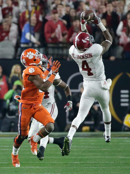 Alabama's Eddie Jackson (4) intercepts a pass in front of Clemson's Ray-Ray McCloud during the first half of the NCAA college football playoff championship game Monday, Jan. 11, 2016, in Glendale, Ariz. (AP Photo/Chris Carlson)