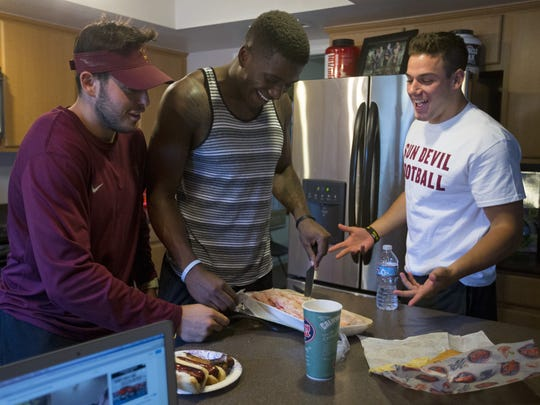ASU football players QB Mike Bercovici, left, Ellis Jefferson, a redshirt freshman receiver, and DB Jordan Simone, share a house with WR DJ Foster in Tempe.