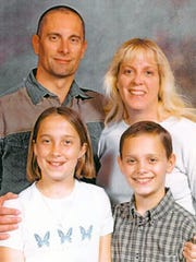 Robert Fisher with his family