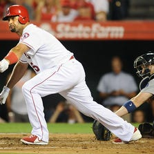 Los Angeles Angels' Albert Pujols hits a three-run double against the Seattle Mariners during the fourth inning on Monday, Sept. 15, 2014, at Angels Stadium in Anaheim, Calif.