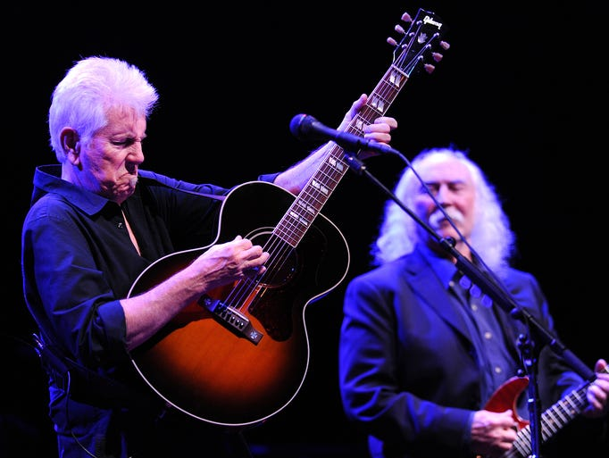 Graham Nash, left, and David Crosby play as Crosby, Stills & Nash perform inside the Murat Theatre at Old National Centre, Friday, March 14, 2014, in Indianapolis.