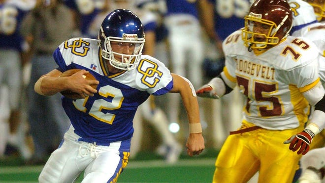 O'Gorman quarterback Dusty Coleman, shown here in the 2004 state finals,  was a thorn in the side of the Rough Riders.