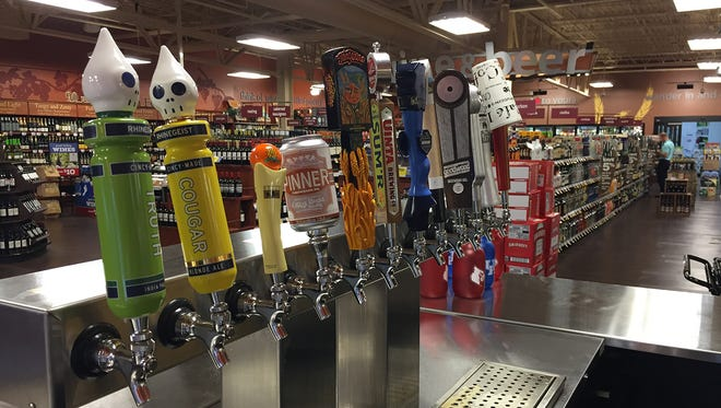 Craft beers on tap at a Columbus Kroger beer station. The grocery store chain is adding more in-store beer taps to locations.