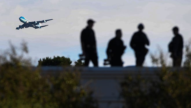 Air Force One flies near the Embassy Suites off Verdae in Greenville where law enforcement officers waited for President Trumps arrival on Monday, October, 16, 2017.