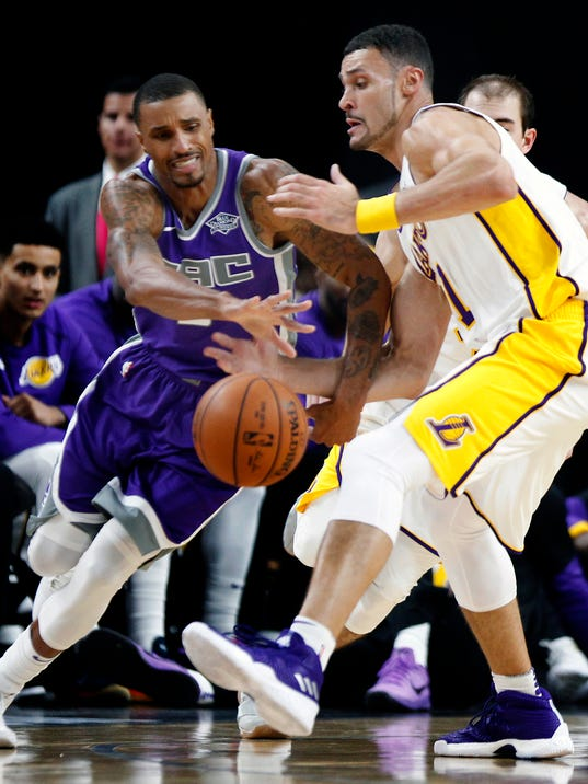 Sacramento Kings guard George Hill (3) fights for control of the ball with Los Angeles Lakers guard Kentavious Caldwell-Pope (1) defending close during the second half of a preseason NBA basketball game at the T-Mobile Arena, Sunday, Oct. 8, 2017, in Las Vegas. The Lakers beat the Kings 75-69. (AP Photo/L.E. Baskow)