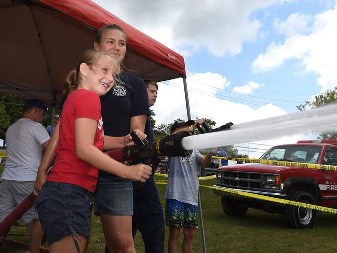 Shaela Byrnes, 8, tries out a Milford Fire Department
