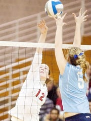 Cornell's Elizabeth Bishop, 12, spikes the ball as