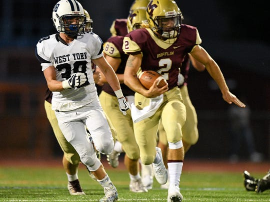 Governor Mifflin's Kamron Wolfe runs away from West York's Eli Bentzel during a 2017 high school football game. Governor Mifflin is one of 13 Berks County schools slated to join the Lancaster-Lebanon League as an associate football member in 2022.