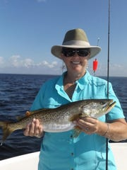 Donna Osborne of Monticello with her first ever spotted sea trout, a 22-inch beauty.