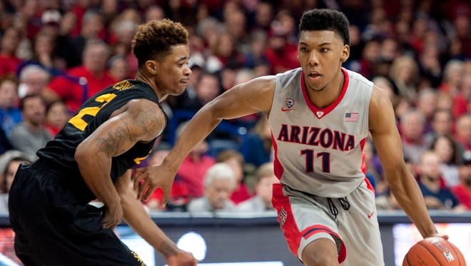 Dec 22, 2015: Arizona Wildcats guard Allonzo Trier (11) dribbles past Long Beach State 49ers guard Nick Faust (2) during the second half at McKale Center. Arizona won 85-70.