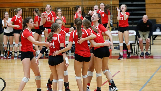 Members of the Kimberly girls volleyball team celebrate during their Fox Valley Association game against Fond du Lac on Oct. 3 at Fond du Lac.