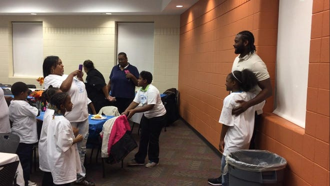 Lions tight end Brandon Pettigrew served a Thanksgiving meal to 25 families at the Dick and Sandy Dauch Detroit campus of the Boys and Girls Club of Southeastern Michigan on Monday, Nov. 14, 2016.